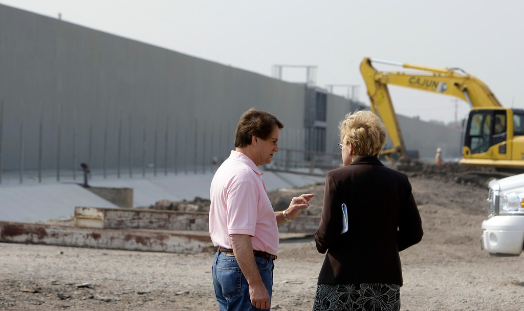 . Rep. Charlie Melacon, D-La., left, talks with Rep. Marcy Kaptur, D-Ohio, Monday, July 21, 2008 in Harvey, La., as they and other congressional leaders tour the damage and construction efforts after Hurricane Katrina in Harvey, La. (AP Photo/Alex Brandon)