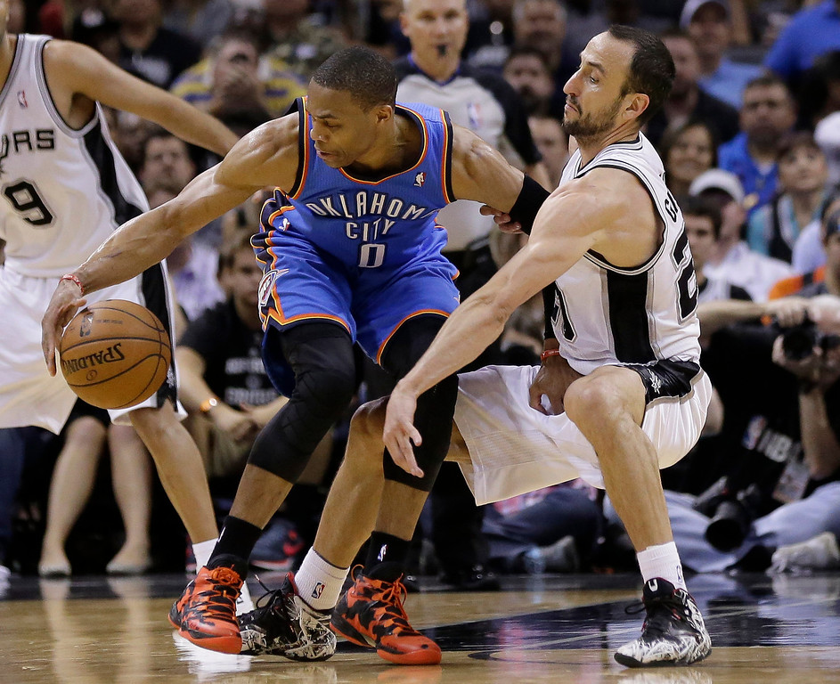 . Oklahoma City Thunder\'s Russell Westbrook (0) is pressured by San Antonio Spurs\' Manu Ginobili (20), of Argentina, during the first half of Game 2 of the Western Conference finals NBA basketball playoff series, Wednesday, May 21, 2014, in San Antonio. (AP Photo/Eric Gay)