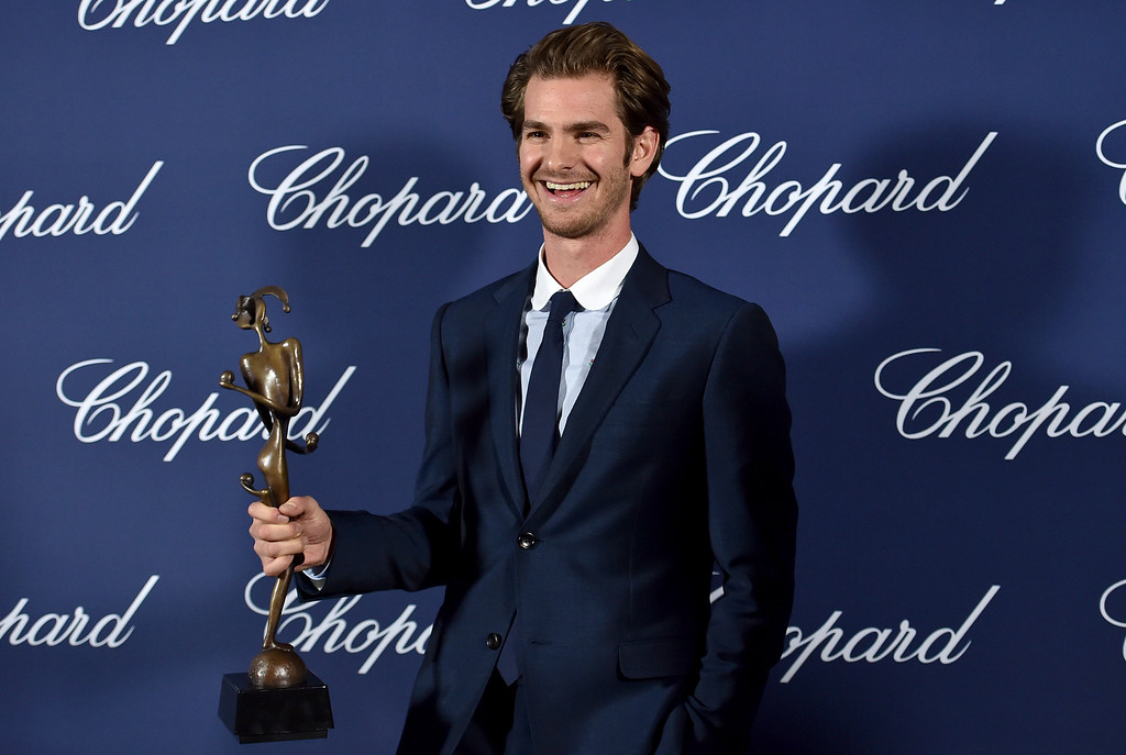 ". Andrew Garfield poses backstage with the spotlight award for ""Hacksaw Ridge\"" at the 28th annual Palm Springs International Film Festival Awards Gala on Monday, Jan. 2, 2017, in Palm Springs, Calif. (Photo by Jordan Strauss/Invision/AP)"