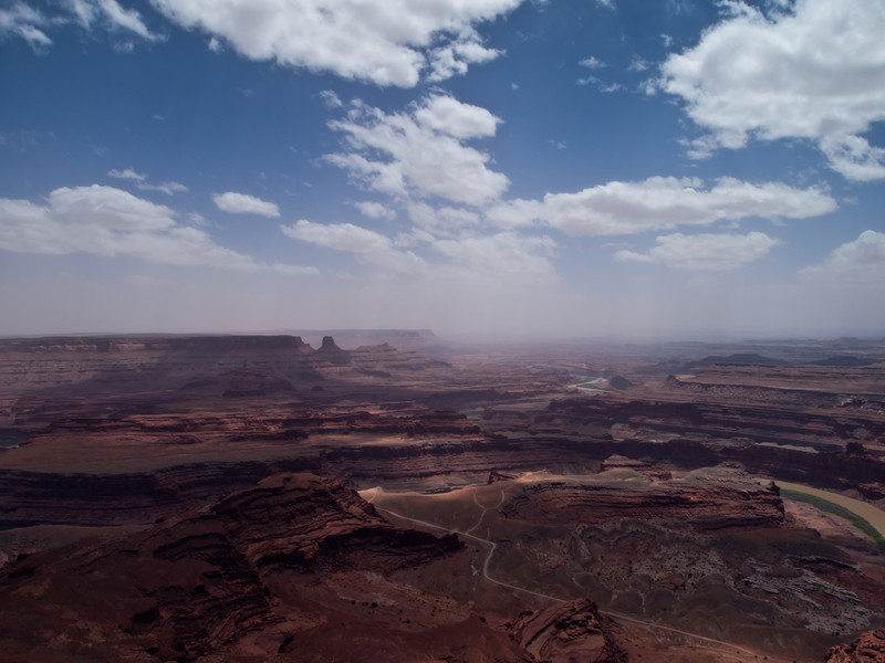 Looking over towards Canyonlands National Park.  The reddish haze is coming from high winds and dust sotrms.