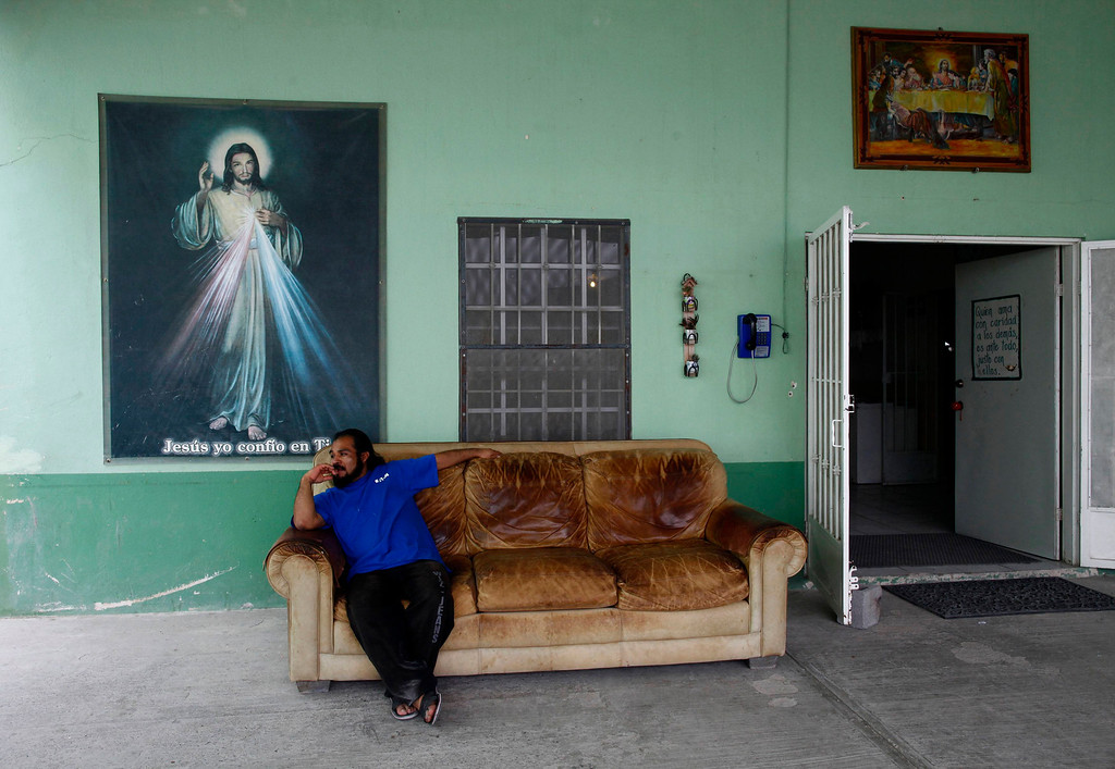 ". A man sits on a couch at Casa del Migrante in Reynosa April 1, 2013. Casa del Migrante provides housing, food, clothing and medical care to people who are planning to cross the border, and to those who have been deported from the United States. Brooks County has become an epicentre for illegal immigrant deaths in Texas. In 2012, sheriff\'s deputies found 129 bodies there, six times the number recorded in 2010. Most of those who died succumbed to the punishing heat and rough terrain that comprise the ranch lands of south Texas. Many migrants spend a few days in a ""stash house\"", such as the Casa del Migrante, in Reynosa, Mexico, and many are ignorant of the treacherous journey ahead. Picture taken April 1, 2013. REUTERS/Eric Thayer"