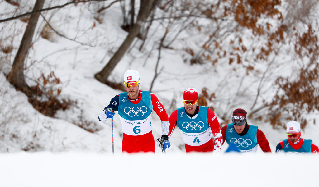 . Martin Johnsrud Sundby, of Norway, left, competes during the men\'s 15km/15km skiathlon cross-country skiing competition at the 2018 Winter Olympics in Pyeongchang, South Korea, Sunday, Feb. 11, 2018. (AP Photo/Matthias Schrader)