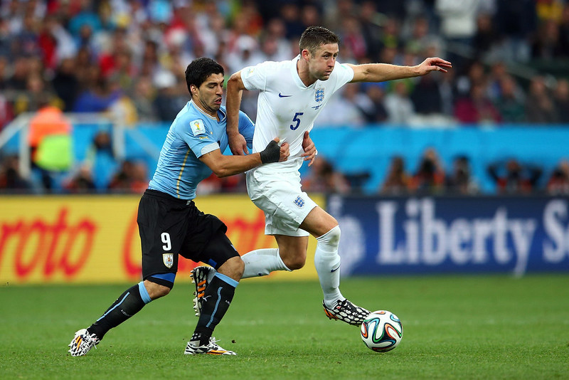 . Luis Suarez of Uruguay holds Gary Cahill of England during the 2014 FIFA World Cup Brazil Group D match between Uruguay and England at Arena de Sao Paulo on June 19, 2014 in Sao Paulo, Brazil.  (Photo by Julian Finney/Getty Images)