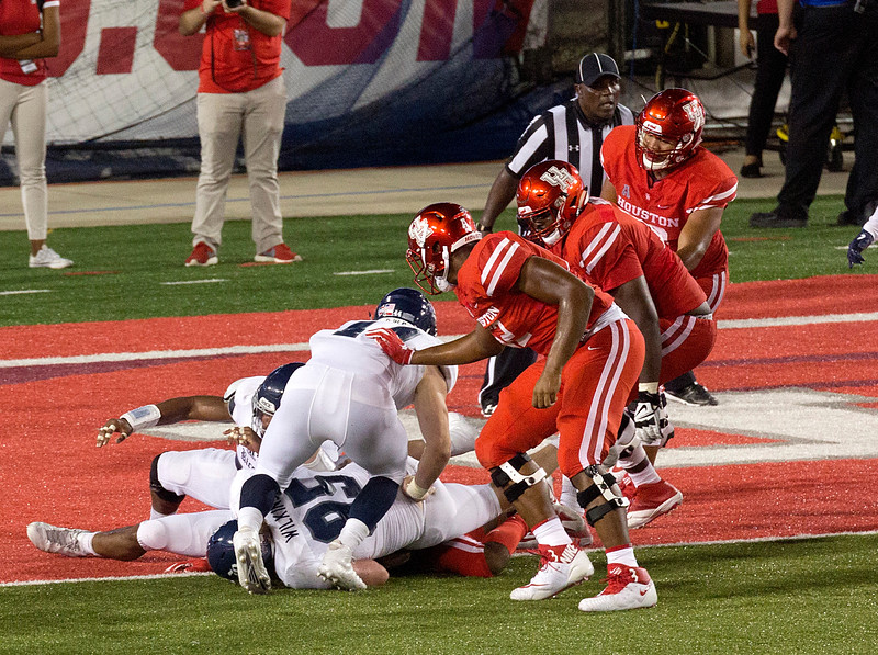 UH is inches short of a touchdown.