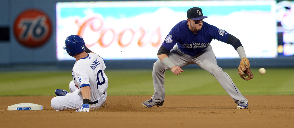 . The Dodgers\' Michael Young #10 beats the throw to the Rockies\' Troy Tulowitzki #2 for a double in the 2nd inning during their game at Dodgers Stadium Saturday, September 28, 2013. (Photo by Hans Gutknecht/Los Angeles Daily News)