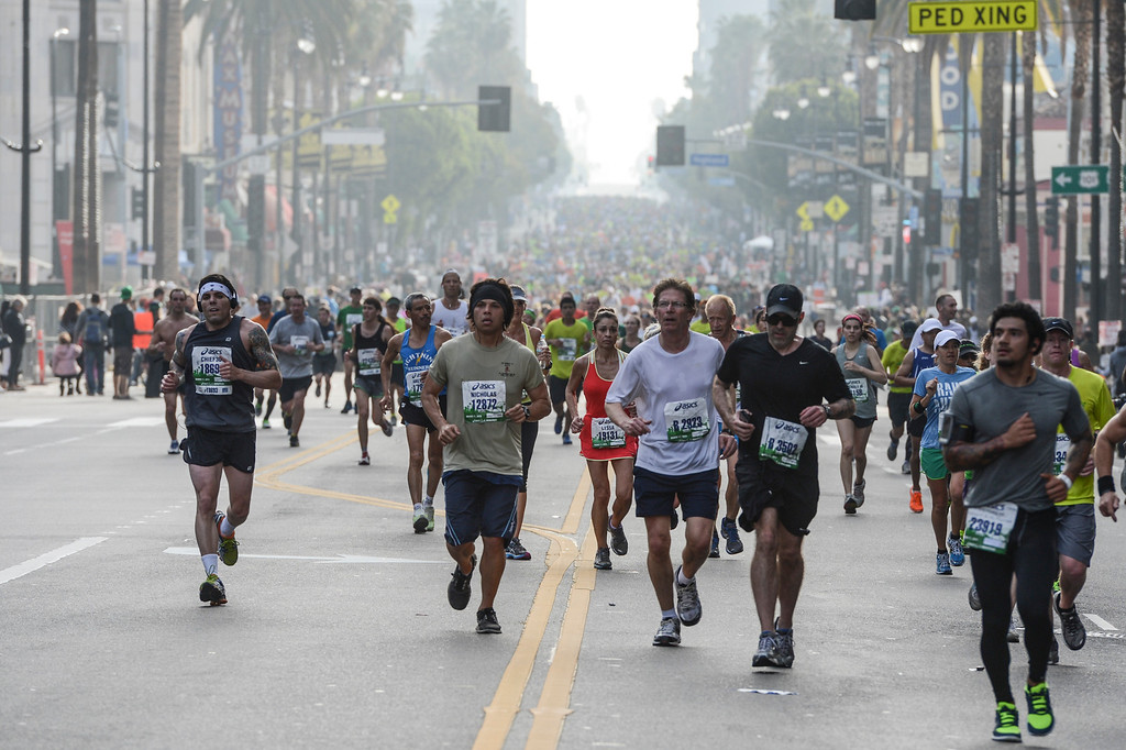 . Runners head up Hollywood blvd. during the 28th Los Angeles Marathon.  Photo by David Crane/Staff Photographer