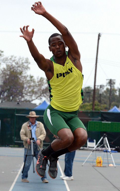 . Long Beach Poly\'s Vincent Calhoun competes in the division 1 long jump during the CIF Southern Section track and final Championships at Cerritos College in Norwalk, Calif., Saturday, May 24, 2014.   (Keith Birmingham/Pasadena Star-News)