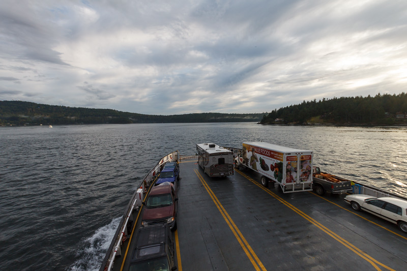 Looking from the top deck of a BC ferryboat with cars, trucks, RVs