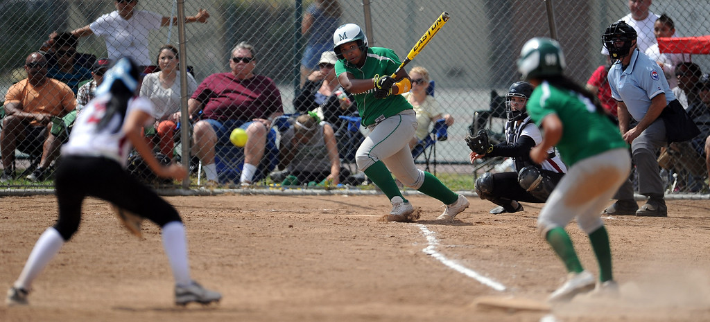 . Monrovia\'s Derek Blow doubles down line for a RBI in the third inning of the Northview Tournament championship softball game against Covina at Northview High School on Thursday, April 4, 2013 in Covina, Calif.  Monrovia won 6-0. 