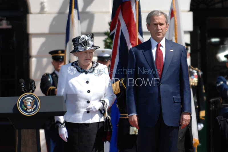 Queen Elizabeth II   during an Official State Arrival Ceremony. She and President George W. Bush listen to their respective National Anthems.