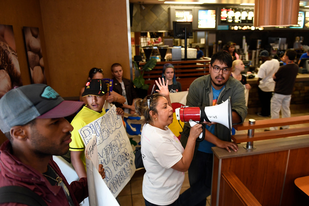 . Denver, CO - ARRIL 14: Lucy Pinon speaks inside the McDonalds at 16th and Cleveland Pl as Denver�s low wage janitors kick off their contract campaign with a rally at Civic Center Park�s Veterans Memorial in downtown and a march past all the buildings where they do their work in Denver. The janitors were joined by local care workers, Fast food, delivery persons and service workers during their  Underpaid Fight for $15 march. April 14, 2016 in Denver, CO. (Photo By Joe Amon/The Denver Post)
