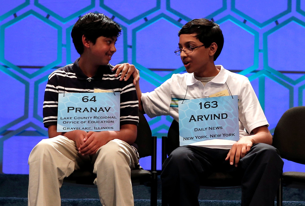 . Arvind Mahankali of New York (R) pats co-finalist Pranav Sivakumar of Illinois after Pranav misspelled a word at the National Spelling Bee at National Harbor in Maryland May 30, 2013. Mahankali won the event.  REUTERS/Kevin Lamarque