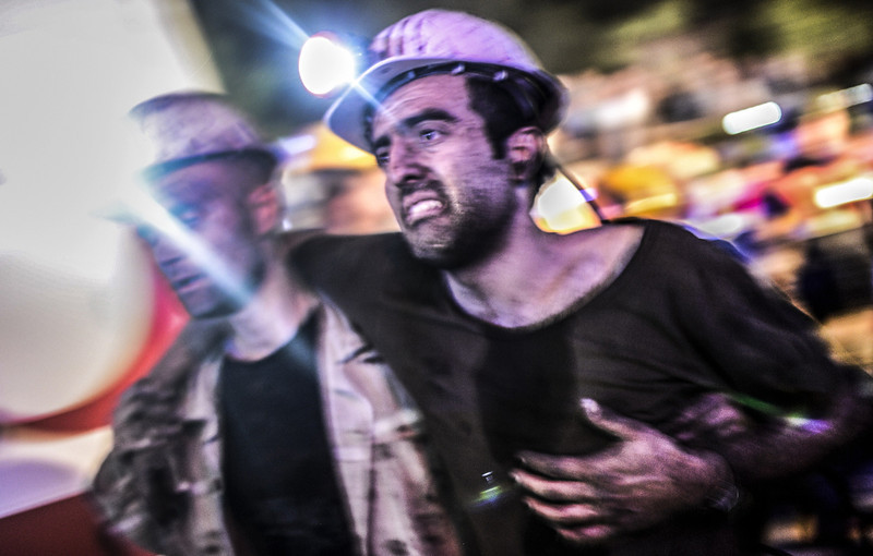 """. An injured miner came out carried by rescuers, on May 13, 2014 after an explosion in a coal mine in Manisa. At least 157 miners were killed in collapsed coal mine in the western Turkish city of Manisa. \""""At least 200-300 workers were working in the mine when an electric fault caused an explosion,\"""" the mayor of Soma, a district of Manisa, told private NTV television. (BULENT KILIC/AFP/Getty Images)"""