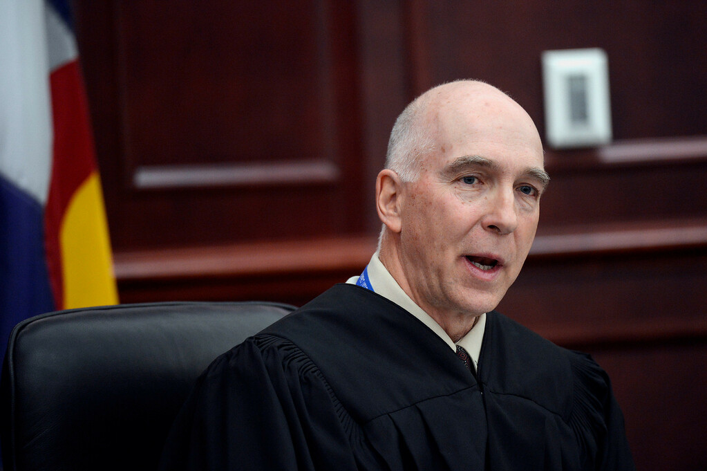 . Judge William Blair Sylvester speaks during James Holmes\' arraignment, where he entered a guilty plea for Holmes, in district court in Centennial, Colo., on Tuesday, March 12, 2013. (AP Photo/Denver Post, RJ Sangosti, Pool)