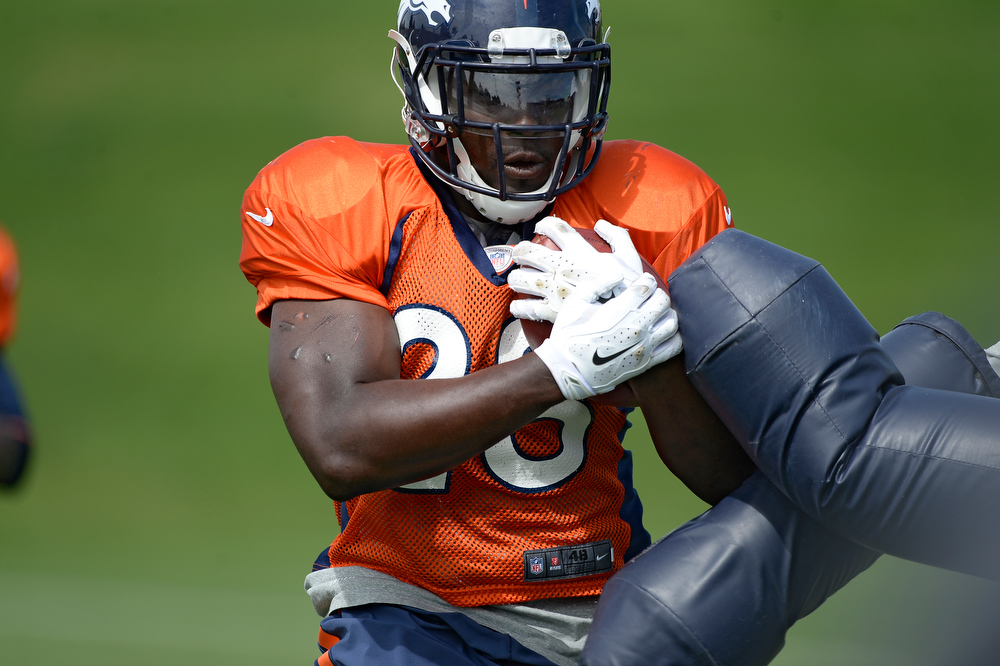 . Denver Broncos running back Montee Ball (28) runs through drills during practice August 26, 2014 at Dove Valley.(Photo by John Leyba/The Denver Post)
