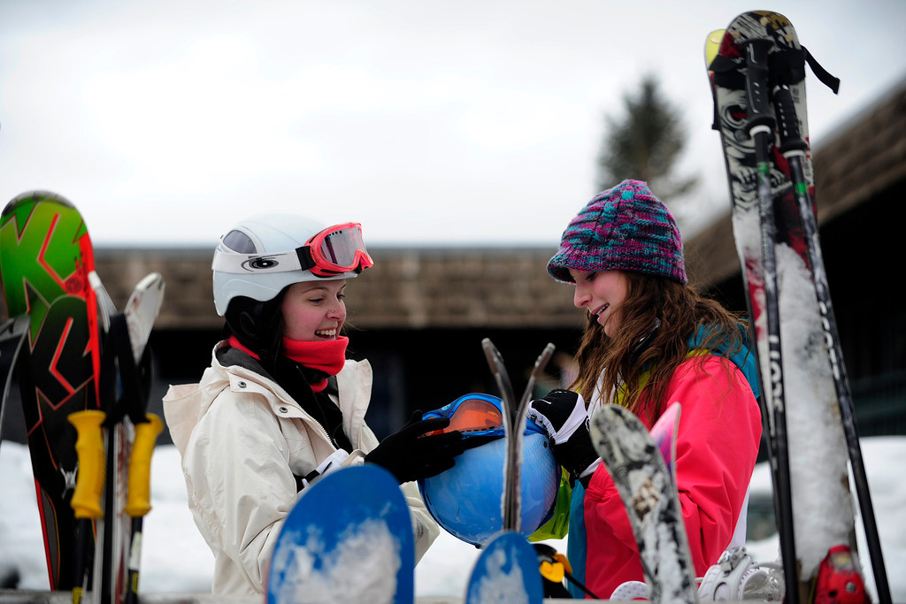 . ASPEN, CO. - JANUARY 24:   Kendall Tomkins, 18,  left, and Jordan Lally, 15, of Virginia Beach, Virginia, joke about their goggles after skiing on Buttermilk Mountain at the 2013 Aspen X Games. They come to the area to ski and see the X Games every year.  (Photo By Mahala Gaylord / The Denver Post)