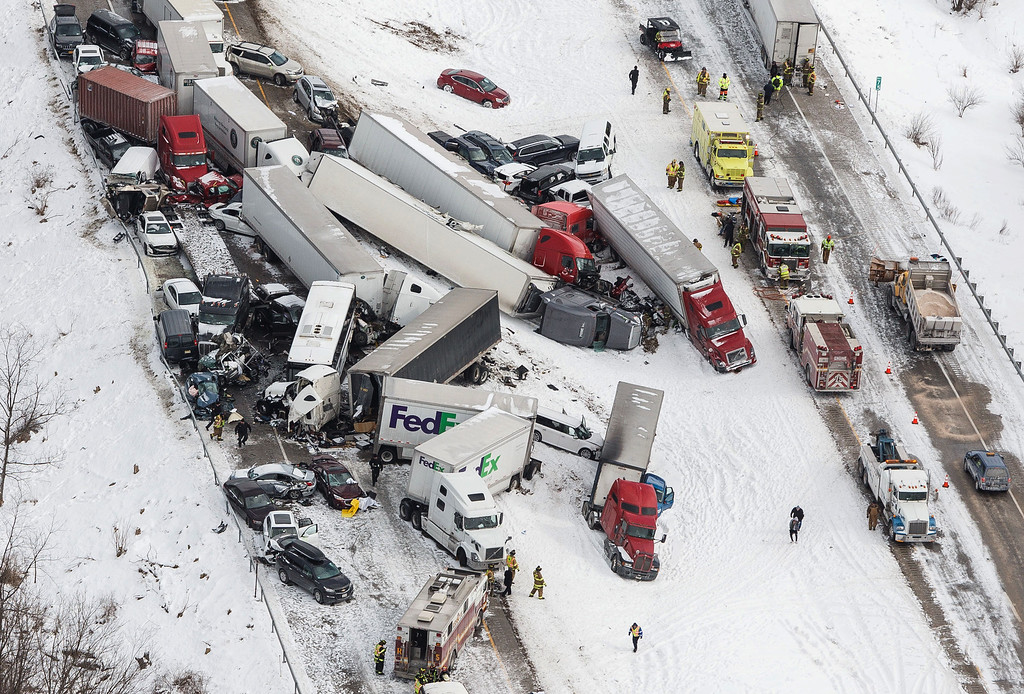 . Vehicles pile up at the site of a fatal crash near Fredericksburg, Pa., Saturday, Feb. 13, 2016. The pileup left tractor-trailers, box trucks and cars tangled together across several lanes of traffic and into the snow-covered median. (James Robinson/PennLive.com via AP)