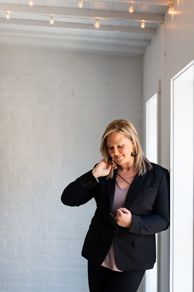 Headshot of Owner Erica Lewis (hingework) after making a BTS video