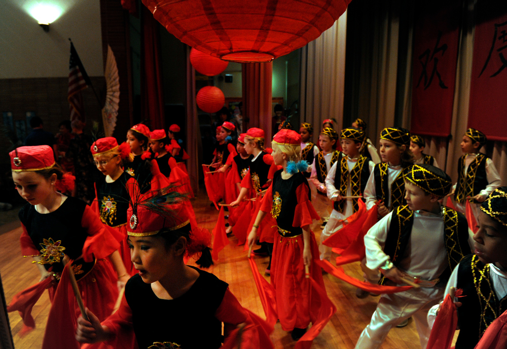 . The third grade performs the Xinjiang (Uyghur) Dance. Students at the Denver Language School ring in the Year of the Snake with their Chinese New Year celebration performance in the school auditorium. Kindergarteners through 4th grade perform traditional dances dressed in colorful Chinese costumes. According to the school principal, Chinese New Year is the most important of the traditional Chinese holidays. Families make way for  good luck by cleaning their homes symbolizing reconciliation and forgetting old grudges in exchange for peace and happiness. The Chinese New Year (Feb. 10) follows the Chinese 12 Zodiac Calendar Year designating 2013 the Year of the Snake. (Photo By Kathryn Scott Osler/The Denver Post)