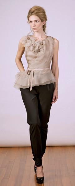 Silk organza top with hand-sewn flower detail, Italian stretch-wool tuxedo pants.