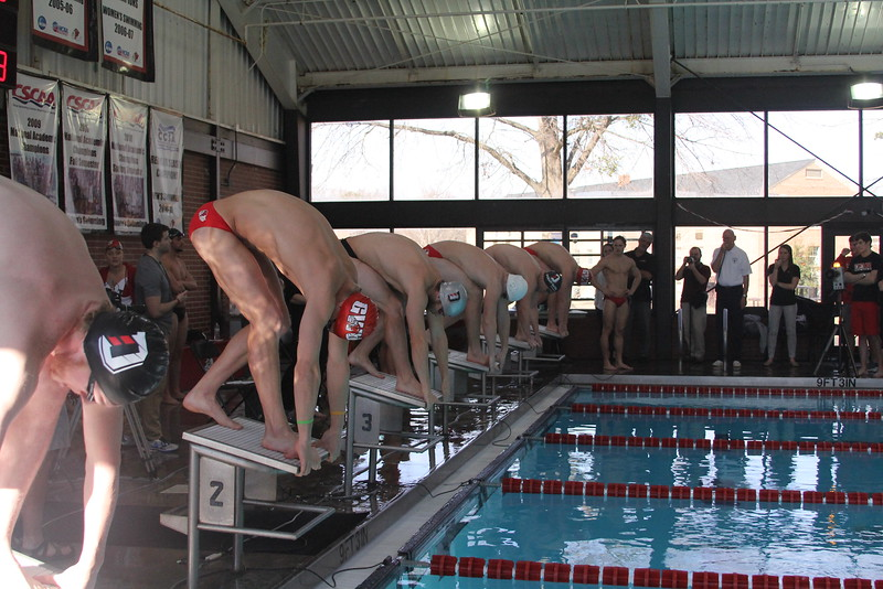 Swimmers get ready to start their race.