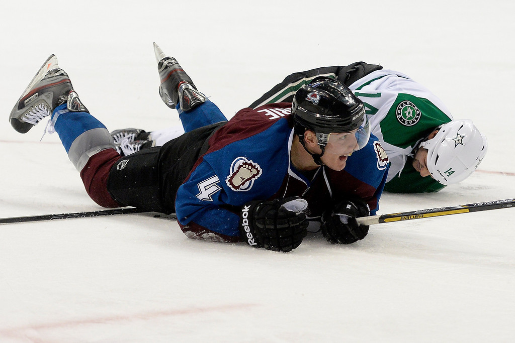 . DENVER, CO - DECEMBER 16: Colorado Avalanche defenseman Tyson Barrie (4) reacts to making his first goal of the season as Dallas Stars left wing Jamie Benn (14) lies on the ground behind him after he fell on the attempt during the third period of the Avs\' 6-2 win. The Colorado Avalanche hosted the Dallas stars at the Pepsi Center. (Photo by AAron Ontiveroz/The Denver Post)