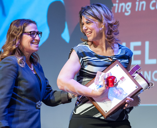 04/23/18 Wesley Bunnell | Staff The Consolidated School District of New Britain held their Excellence in Education Awards Ceremony on Monday evening at New Britain High School. CSDNB Teacher of the Year Shelly Bjorklund smiles as she walks on stage with Lincoln Elementary School Principal Lisa Torres.