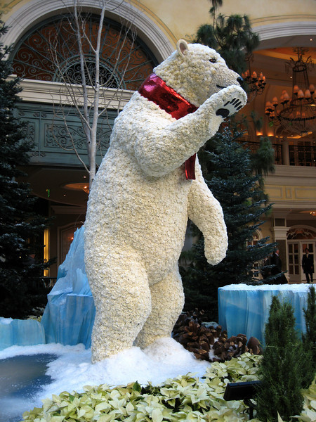 The bear, and many other displays, are made from flowers and plants.