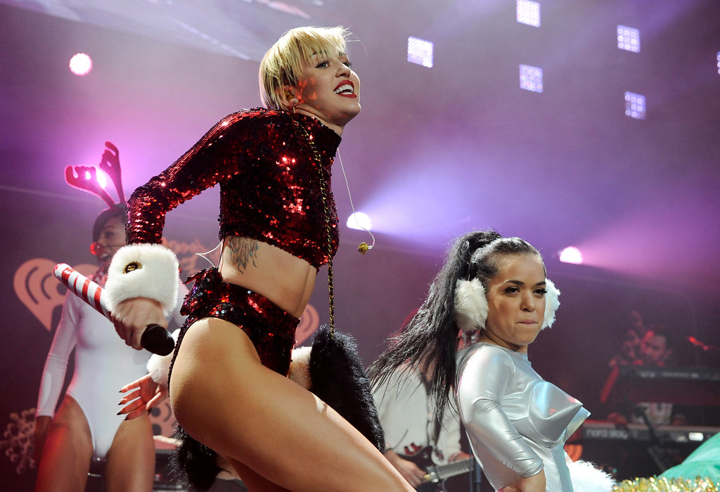 """. FILE - This Dec. 6, 2013 file photo shows Miley Cyrus performing during the KIIS-FM Jingle Ball concert at Staples Center in Los Angeles. MTV has declared that Miley Cyrus is the best artist of the year. MTV said Monday, Dec. 9, that the VMA duet on \""""We Can\'t Stop\"""" and \""""Blurred Lines\"""" was the year\'s most-watched video on MTV web sites. Similarly, the MTV artist site devoted to Cyrus had more visits than any other artist\'s. (Photo by Chris Pizzello/Invision/AP, File)"""