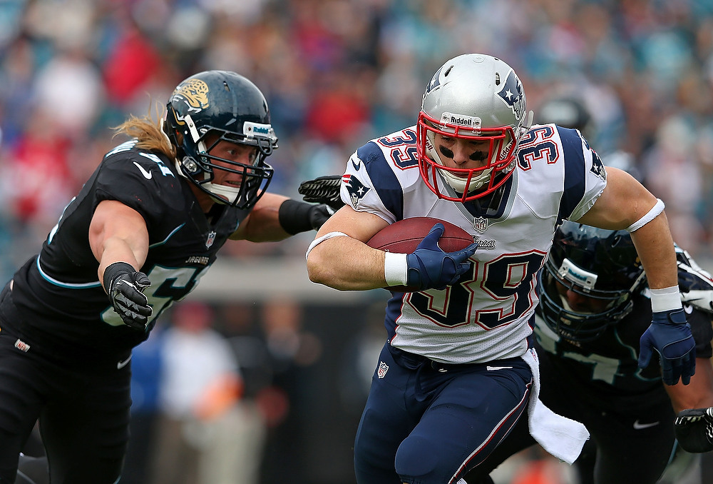 . Danny Woodhead #39 of the New England Patriots is tackled by Paul Posluszny #51 of the Jacksonville Jaguars during a game  at EverBank Field on December 23, 2012 in Jacksonville, Florida.  (Photo by Mike Ehrmann/Getty Images)