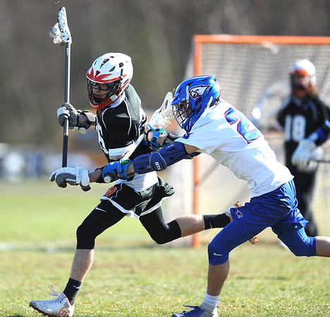 4/10/2019 Mike Orazzi | Staff St. Paul's Kevin Ashworth (23) and Watertown's Ian Judd (26) during boys lacrosse in Bristol Wednesday.