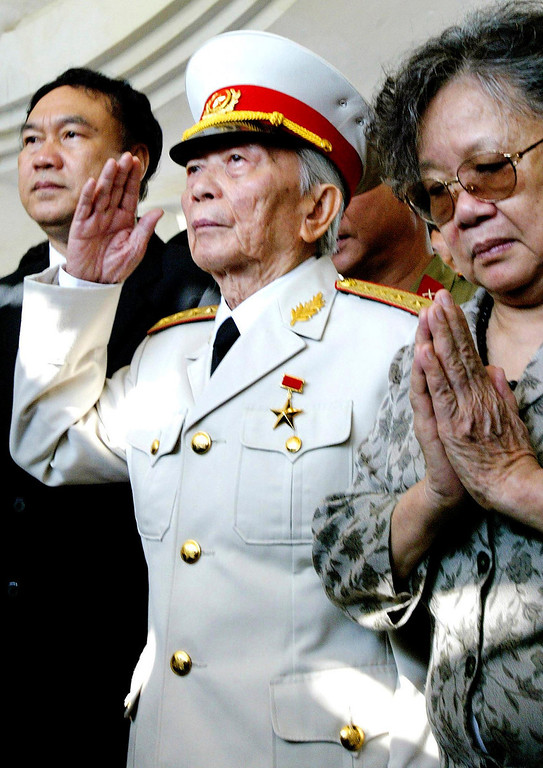 . In this April 18, 2004 file photo, Gen. Vo Nguyen Giap salutes his fallen comrades at a shrine of the Dien Bien Phu\'s war cemetery in Dien Bien Phu, Vietnam. Officials say legendary Gen. Giap, the military mastermind who drove the French and the Americans out of Vietnam, died at a Hanoi hospital Friday, Oct. 4, 2013, at age 102. He was the country\'s last famous communist revolutionary, and used ingenious guerrilla tactics to overcome enormous odds against superior forces. (AP Photo/Richard Vogel, File)