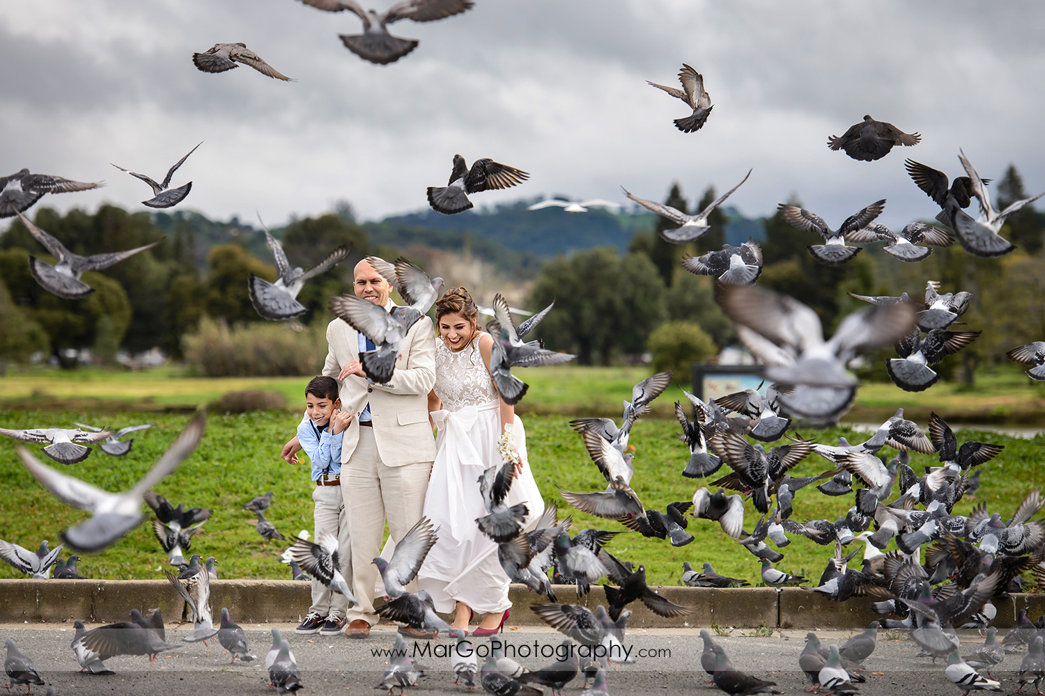 bride and groom with birds at Martinez Regional Shoreline