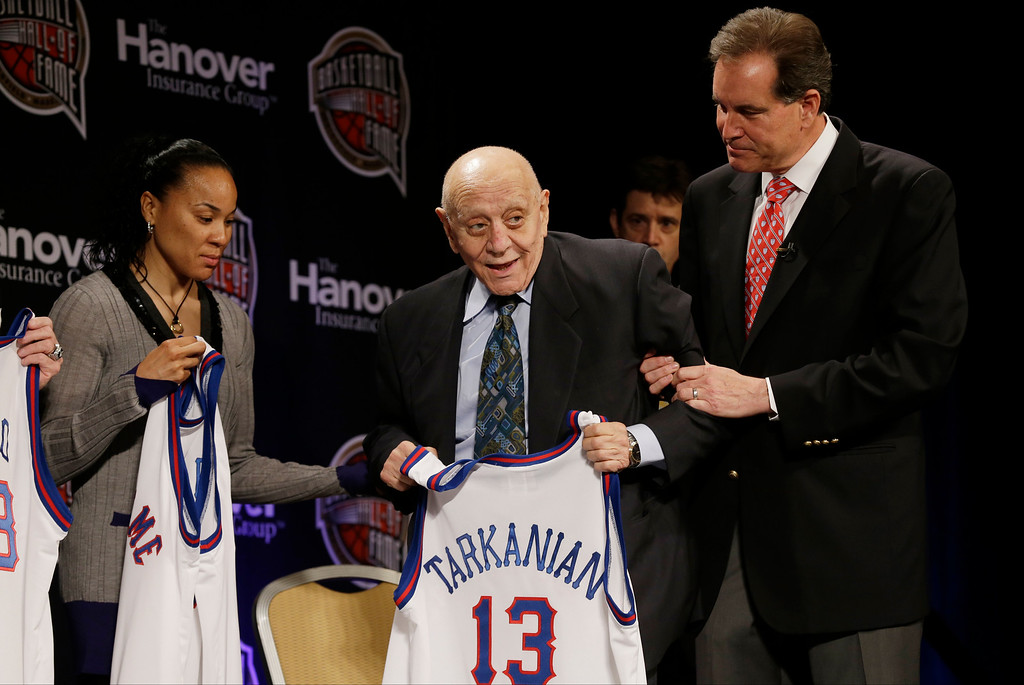 . Former UNLV coach Jerry Tarkanian, center, is helped on stage by CBS announcer Jim Nantz, right, during the Naismith Memorial Basketball Hall of Fame class announcement, Monday, April 8, 2013, in Atlanta, Georgia. (AP Photo/Charlie Neibergall)