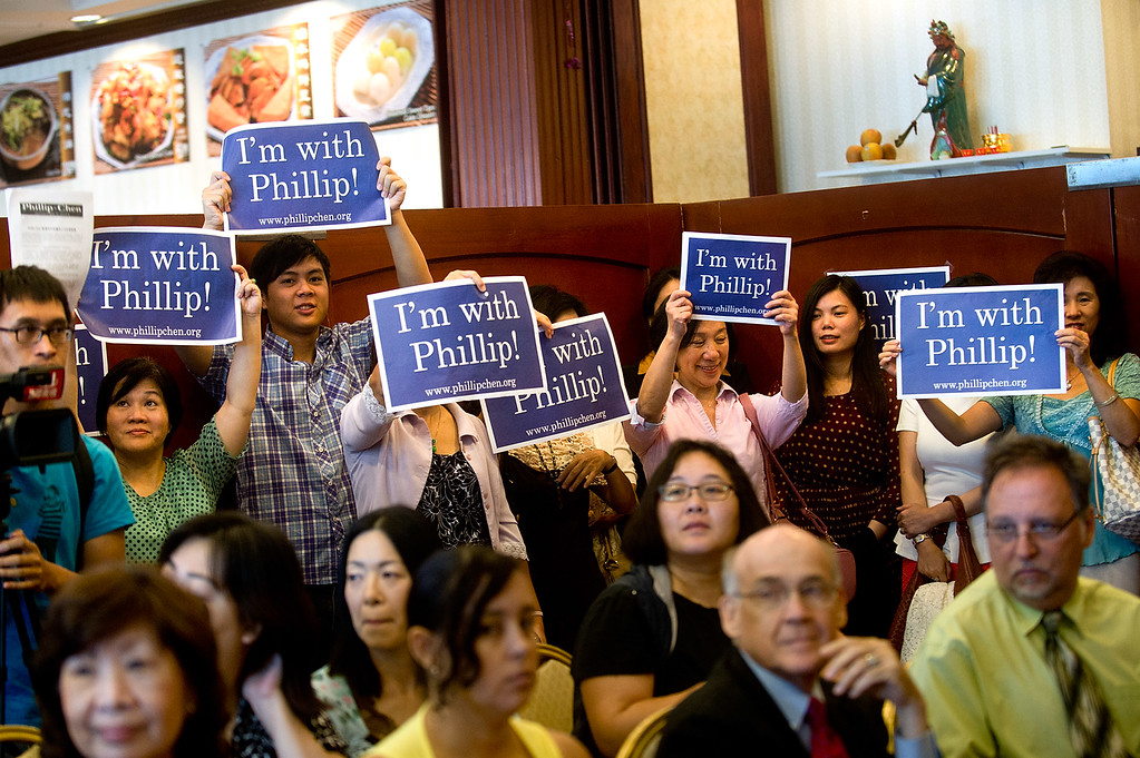 . Phillip Chen\'s campaign supporters hold up signs during his announcement in his run for 55th State Assembly District at Seafood Village Restaurant in Rowland Heights on Thursday, July 8, 2013. The Walnut Valley school board member is running in the 55th Assembly district currently represented by Assemblyman Curt Hagman, who is not running for reelection due to term limits. (SGVN/Staff photo by Watchara Phomicinda)
