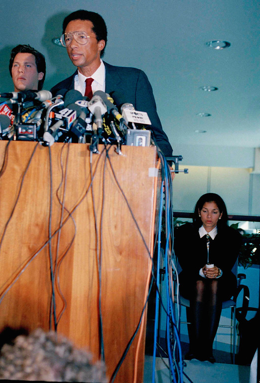 . Famed tennis player Arthur Ashe talks to reporters during a news conference on April 9, 1992 in New York  where he announced he has AIDS.   At right is his wife Jeanne. (AP Photo/Marty Lederhandler)