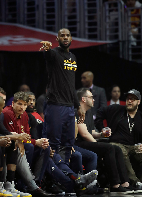 . Cleveland Cavaliers\' LeBron James watches from the bench during the first half of an NBA basketball game against the Los Angeles Clippers, Saturday, March 18, 2017, in Los Angeles. (AP Photo/Jae C. Hong)