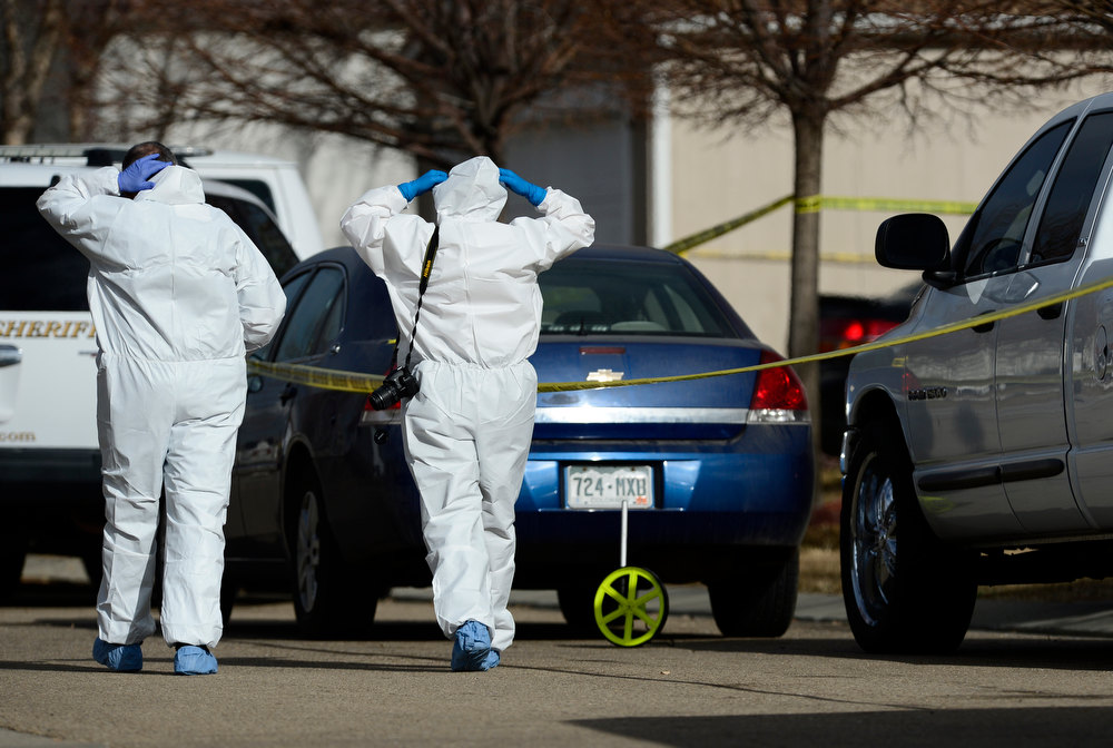 . Investigators suit up as they walk to the scene, Tuesday, Dec. 18, 2012, in Longmont. (Matthew Jonas/Times-Call)