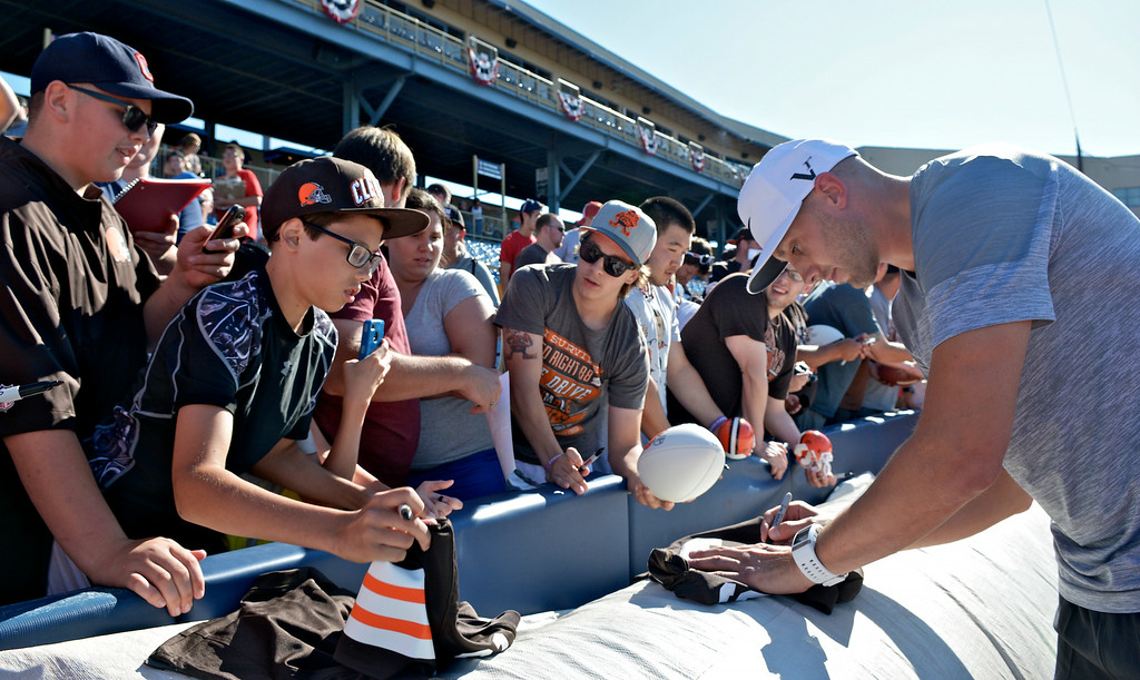 . Jeff Forman/JForman@News-Herald.com Brian Hoyer signs autographs before  the Joe Haden and Friends Softball Game July 17 at Classic Park.