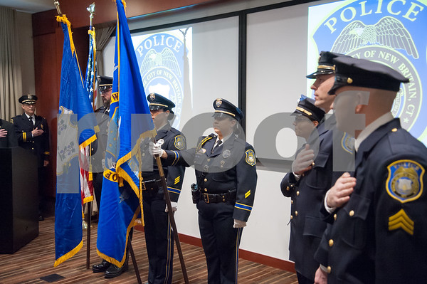 02/15/18 Wesley Bunnell | Staff The New Britain Police Department promoted three of its own including the first female Captain in its history. A police color guard stands at the front of the room at the beginning of the ceremony.