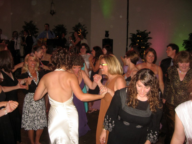 Abby dances with Hope (mother of the bride) and Janice (friend of the bride)