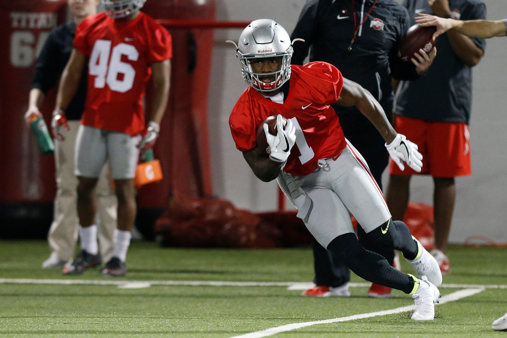 . Ohio State wide receiver Johnnie Dixon runs the ball during spring NCAA college football practice Tuesday, March 7, 2017, in Columbus, Ohio. (AP Photo/Jay LaPrete)
