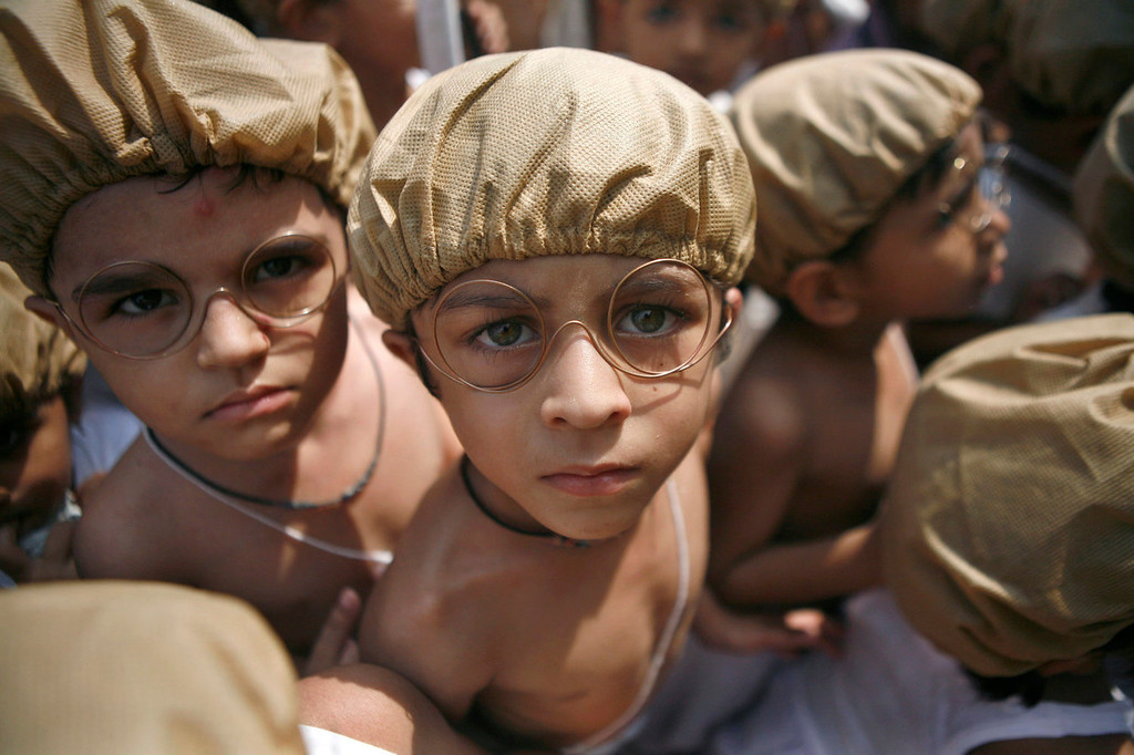 . Indian children dressed as Mahatma Gandhi assemble at an event to mark Gandhi\'s birth anniversary in Chennai, India, Wednesday, Oct. 2, 2013. (AP Photo/ Arun Sankar K)