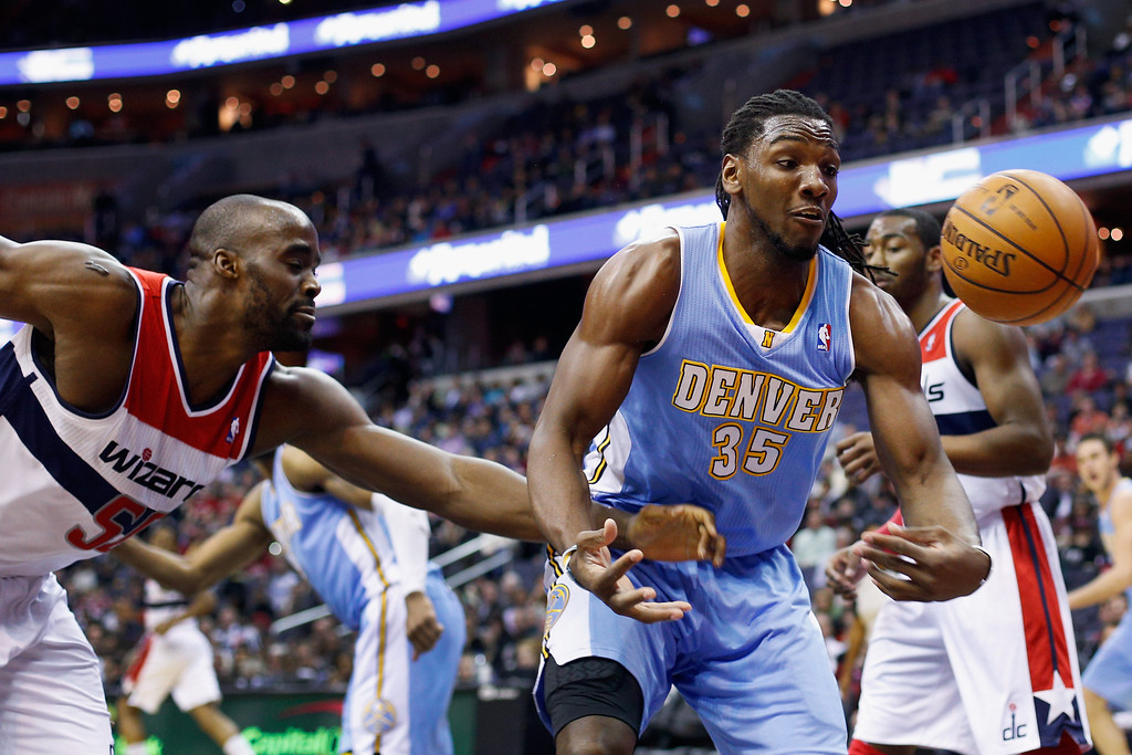 . WASHINGTON, DC - FEBRUARY 22: Emeka Okafor #50 of the Washington Wizards and Kenneth Faried #35 of the Denver Nuggets go after a loose ball during the first half at Verizon Center on February 22, 2013 in Washington, DC.  (Photo by Rob Carr/Getty Images)