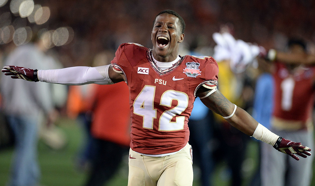 . Florida State tight end Shayne Broxsie (42) reacts after defeating Auburn 34-31 during the BCS National Championship game at the Rose Bowl in Pasadena, Calif., on Monday, Jan. 6, 2014. 