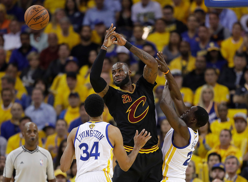 . Cleveland Cavaliers forward LeBron James, center, loses the ball while guarded by Golden State Warriors guard Shaun Livingston (34) and forward Draymond Green during the first half of Game 5 of basketball\'s NBA Finals in Oakland, Calif., Monday, June 12, 2017. (AP Photo/Marcio Jose Sanchez)