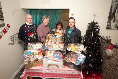 "A Facebook page which was set up in January 2014 ""Newry Helping Hnads"" has collected 50 food hampers which will be distrubited to families throughout the city. The page admins wish to thank Border Taxis for using their premises as a drop off point. Pictured with Colly Coyle is Paddy McKay (Proprietor Border Taxis), Mickey Brady and Valerie Harte. R1551012"