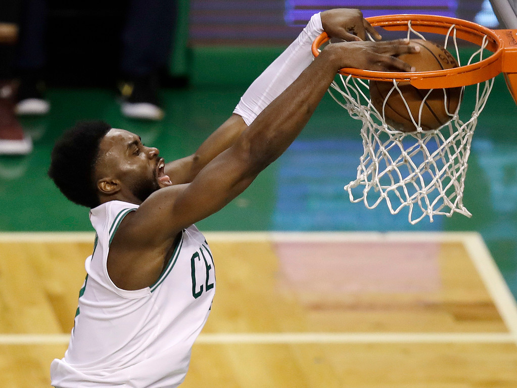 . Boston Celtics guard Jaylen Brown dunks against the Cleveland Cavaliers during the second half in Game 7 of the NBA basketball Eastern Conference finals, Sunday, May 27, 2018, in Boston. (AP Photo/Charles Krupa)