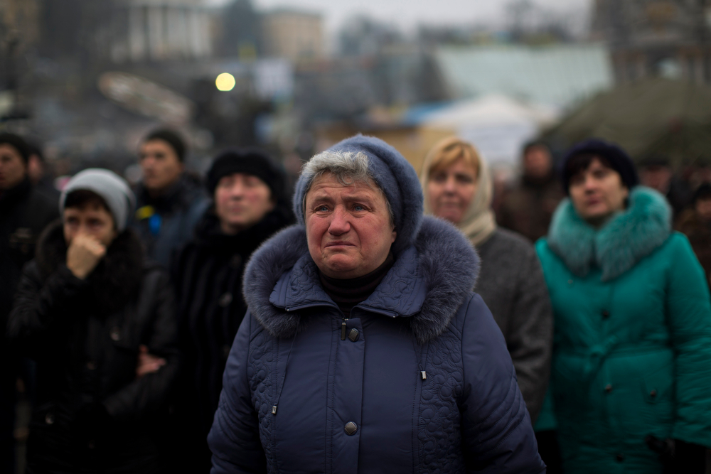 . A women cries as she is listening a speech in Kiev\'s Independence Square, the epicenter of the country\'s current unrest, Ukraine, Saturday, March 1, 2014. The pro-Russian prime minister of Ukraine\'s restive Crimea is claiming control of all military forces, police and other security services in the region. In a statement reported by local and Russian news agencies on Saturday, Sergei Aksenov declares that the armed forces, the police, the national security service and border guards will answer only to his orders. He says that any commanders who don\'t agree should leave their posts. (AP Photo/Emilio Morenatti)