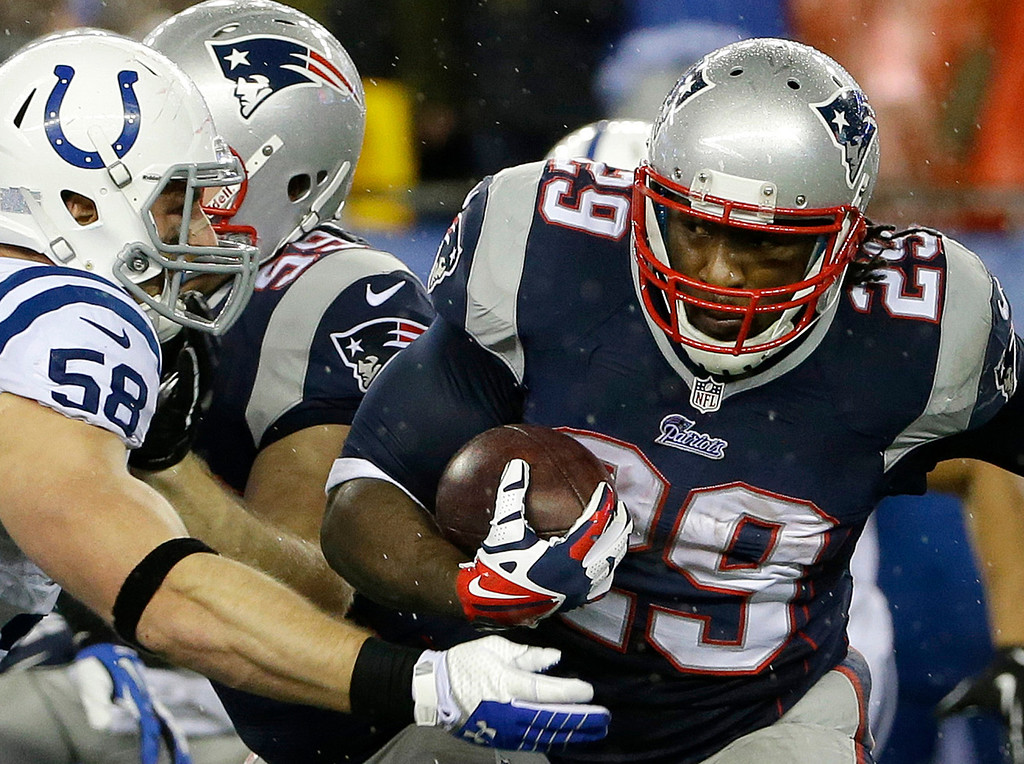 . New England Patriots running back LeGarrette Blount (29) carries the ball around Indianapolis Colts linebacker Andy Studebaker (58) during the first half of an AFC divisional NFL playoff football game in Foxborough, Mass., Saturday, Jan. 11, 2014. (AP Photo/Matt Slocum)